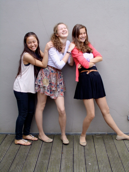Her daughters and a friend pose for my camera. BEAUTIFUL!!