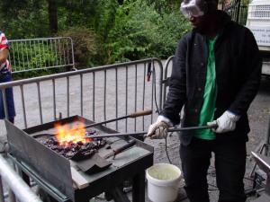 A rod-iron gate maker at work.